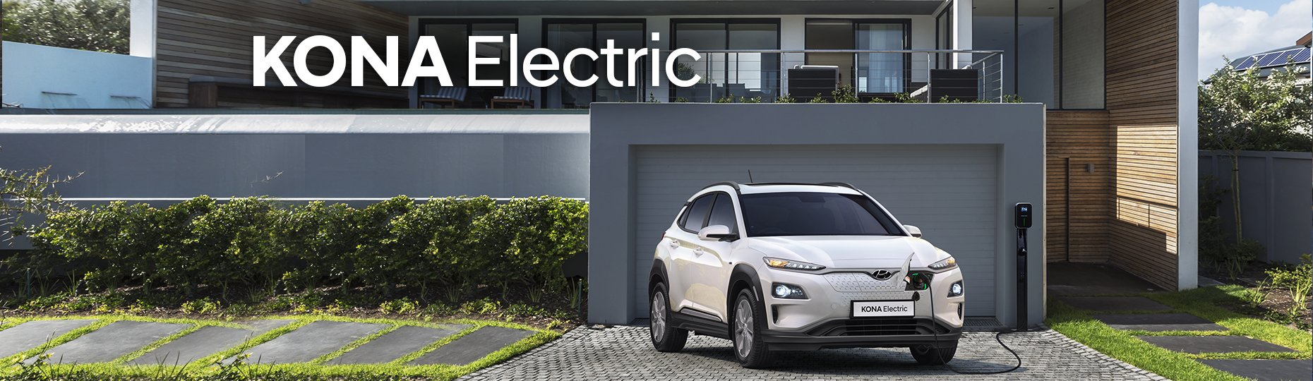 white_color_suv_electric_charging.jpg